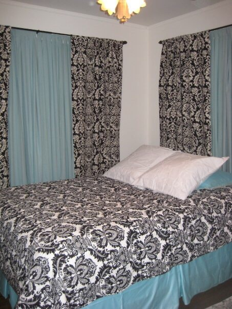 bedroom with brocade and blue