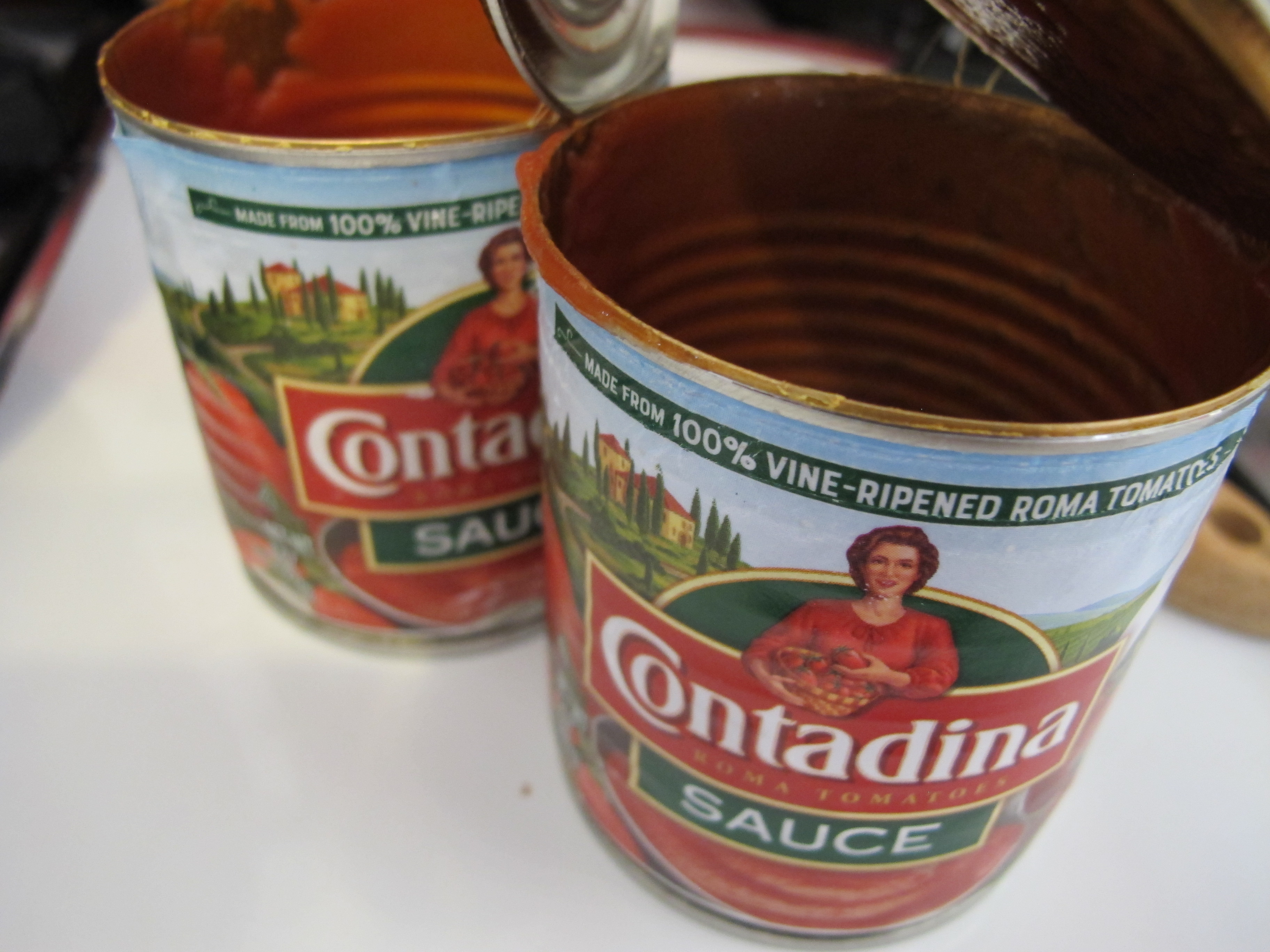 cans of tomato sauce